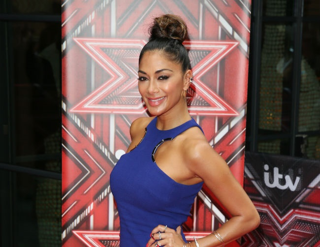 "Nicole Scherzinger is ""very happy"" with Grigor Dimitrov"