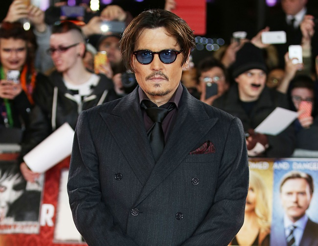 Johnny Depp admires Amber Heard over generous charity donations