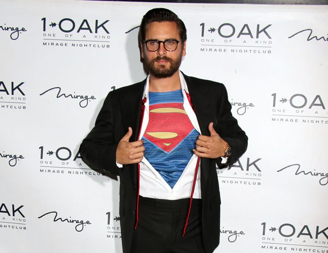 "Scott Disick is ""on his best behavior"" to impress Kourtney Kardashian"