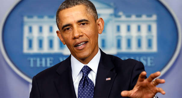 President Obama defends health care law's delay